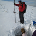 The profiler probe in action vs. nearby snowpit measurements. Photo: Dan Berisford. Probe held by Alexandra Arnsten and snowpit by Jen Petrzelka. February 2009.