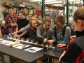 Students learn about radiocarbon dating using M&Ms in the Laboratory for AMS Radiocarbon. Photo by Jen Hall-Bowman, April 2012.