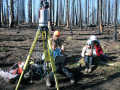 The research group collects laser scans with a technician from UNAVCO.  The scans helped characterize the forest around and intensively burned area near previous snow measurements in the Valles Caldera, NM, summer 2014. Photo: Adrian Harpold.