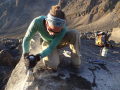 Sarah Crump samples a glacier moraine boulder for cosmogenic radionuclide dating. Photo by Kurt Refsnider.