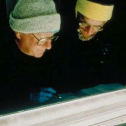 Mark Meier and Richard Alley study an ice core from GISP2 (note the annual dust layers visible in the core segment) at the National Ice Core Laboratory (NICL). Mark was the first Director of NICL. Photo by Ken Abbott, CU Office of Public Relations, Boulder.
