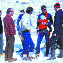 Mark Meier (in plaid shirt) and fellow glaciologists (including Bob Krimmel, holding child) on Glacier Peyto in the Canadian Rockies. Photo by Vladimir Kotlyakov, 1977.