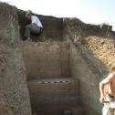 Recording stratigraphy at profile #21 in August 2013 (photo by J.F. Hoffecker).