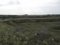 Shlyakh site, looking west from edge of quarry (photo by J.F. Hoffecker).