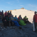Billy Armstrong discusses ogive formation with students on the Juneau Icefield Research Program. Aug 2016.